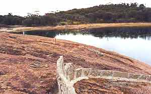 Wave Rock concrete wall directs water to reservoir
