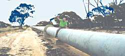 Bill astride water pipeline