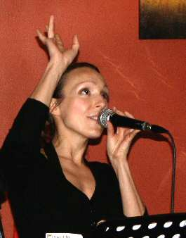 Singer Juliane Pasternak reaches for the sky.