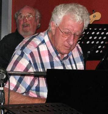 Industry veteran bassist Ivan Videky (dec.) and Grahame Taylor, piano, in band Spellbound.