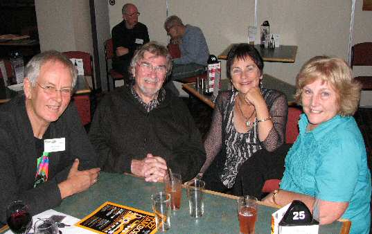 All happy smiles at table of (from L) Dave Richard (gt/voc), Ray Haynes (kb), Lynne Gough (voc/perc) and Roz Haynes.