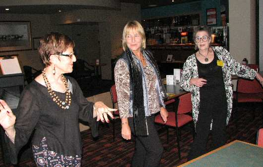 Finding the music irresistible are (from L) Janet Arndt, Annie Smith and Gigi Hellmuth.