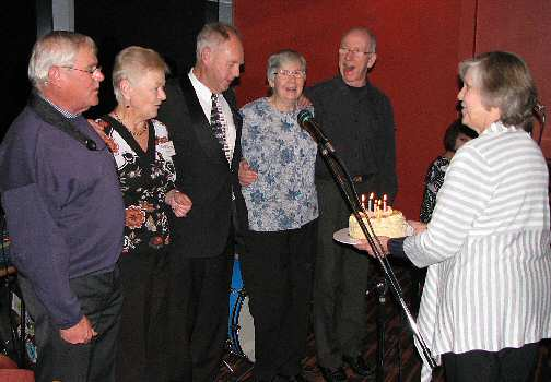 May birthdays, from L: Bob Casely, Thea Boyes, Neville Turner, Glenyce Leithhead, John Hoare, with cake gal Berri Biss.