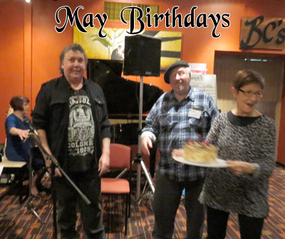 May birthdays, from L: Rick Litchfield and Ivan Videky (dec.), with veteran club member Janet Arndt looking after the cake and candles.