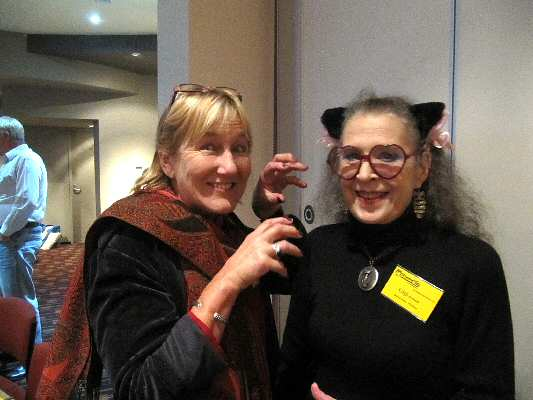 Well-known singer Annie Smith in kittenish mood with assistant secretary and photographer Gigi Hellmuth.