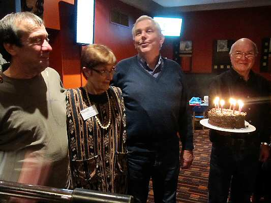 June birthdays. From L: Franco Vitiello, Janet Arndt, Barry Henderson, with cake technologist and Treasurer Colin Garrett.
