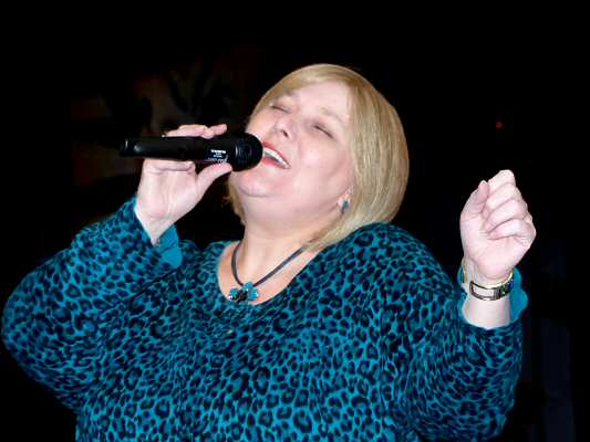 Silky-smooth jazz vocalist Anita Harris fully into the spirit of the song.