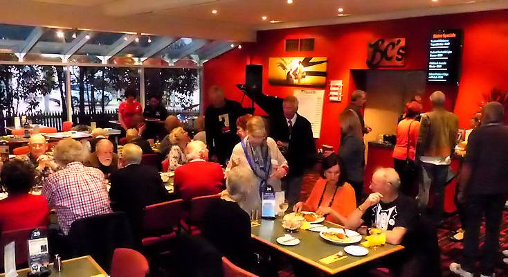 Mixing and mingling galore amidst the colourful interior of the club's performance venue in the Bentleigh Club Bistro.